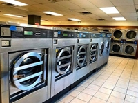 absentee owned laundromat with - 1